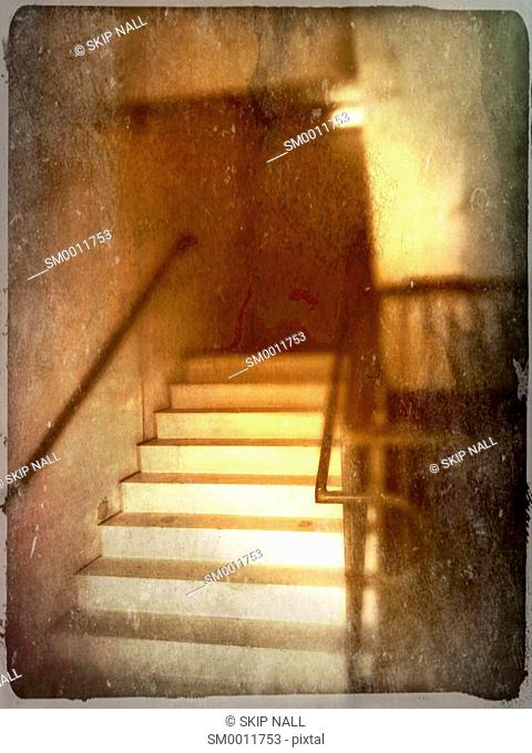 A stairway bathed in golden light