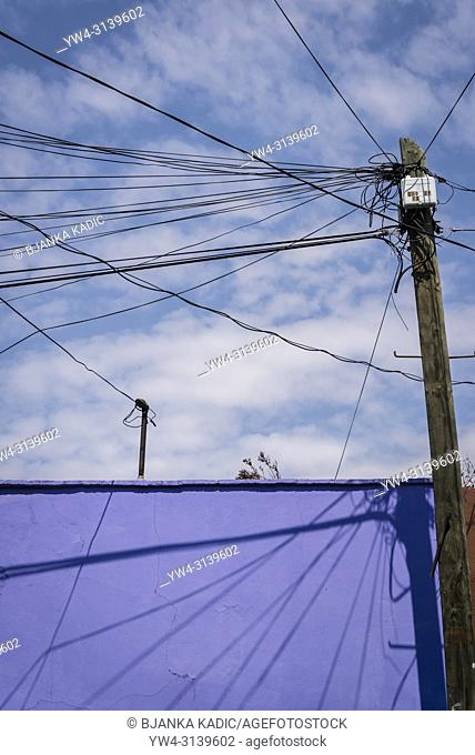 Purple house and utility cables, Cholula, Puebla state, Mexico