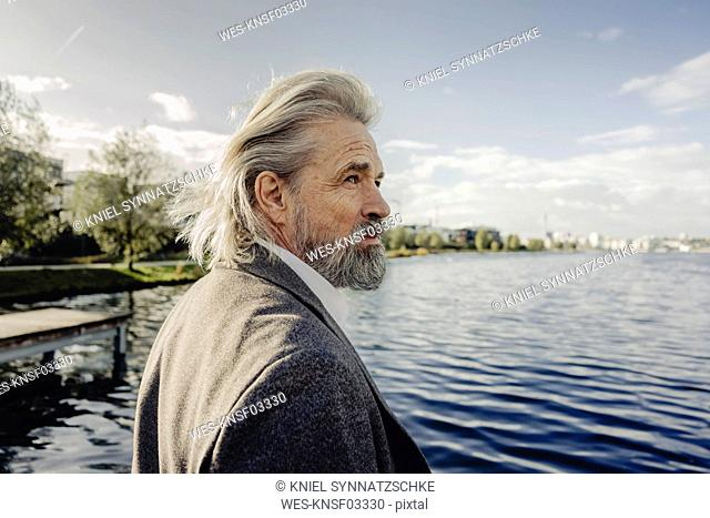 Portrait of serious senior man at a lake