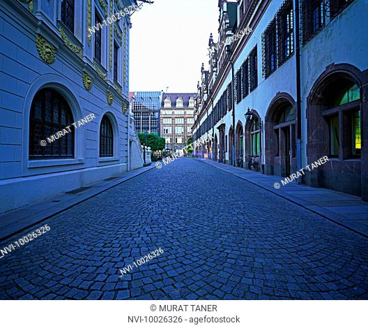 Cobblestone street between old bourse building and Old City Hall, Leipzig, Germany