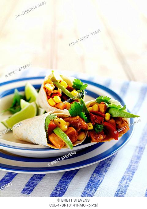 Plate of chicken and vegetable wraps