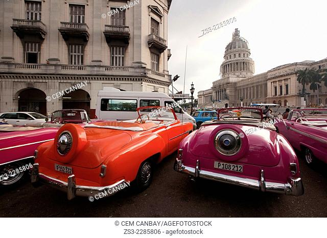 Vintage American cars near the Capitolio building in Central Havana, Cuba, West Indies, Central America