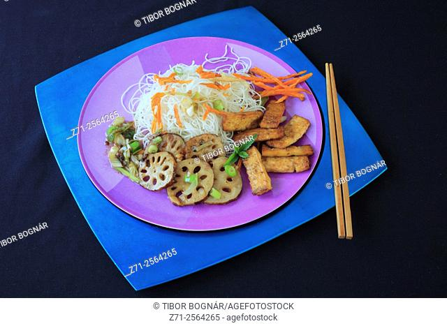 Pressed lemongrass tofu, lotus root caramelized with spring onions and sweet potato fries