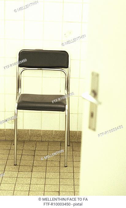 Black chair with metal jacket