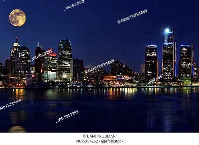 Moon above the skyline of downtown Detroit, Michigan, USA seen at night. Detroit is known as The Motor City, The D, Motown, Hockeytown and the Murder City
