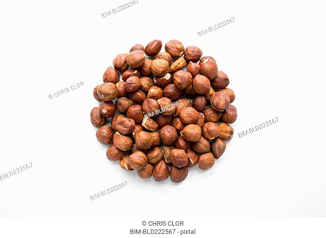 Pile of hazelnuts in shape of a circle
