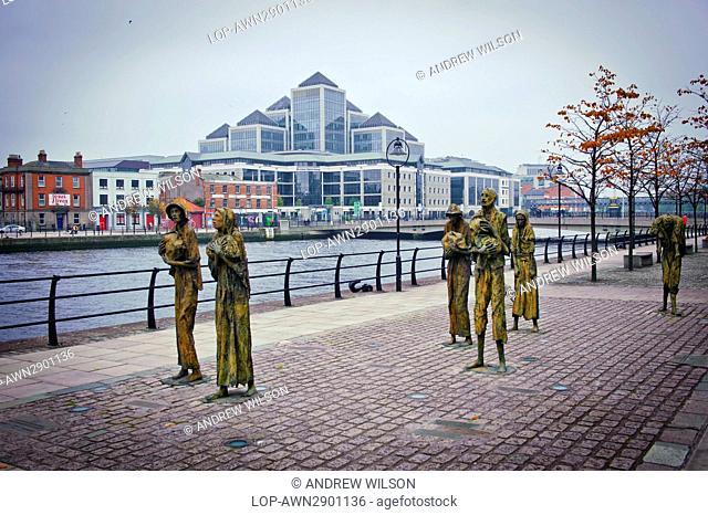Ireland, Dublin, Dublin. Famine memorial statues on Custom House Quay, Dublin, designed and crafted by Dublin sculptor Rowan Gillespie