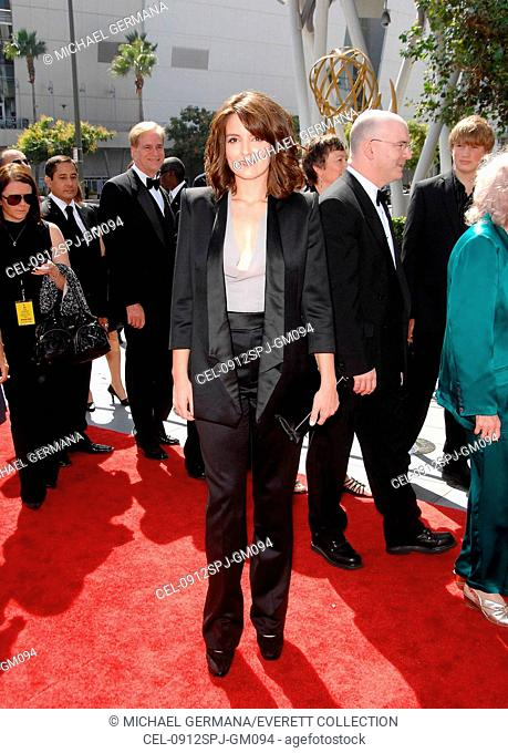 Tina Fey (wearing a Calvin Klein suit, shoes, and bag) at arrivals for 2009  Creative Arts EMMY AWARDS - Arrivals, Nokia Theatre, Los Angeles, CA  September ... d2719c4f0b