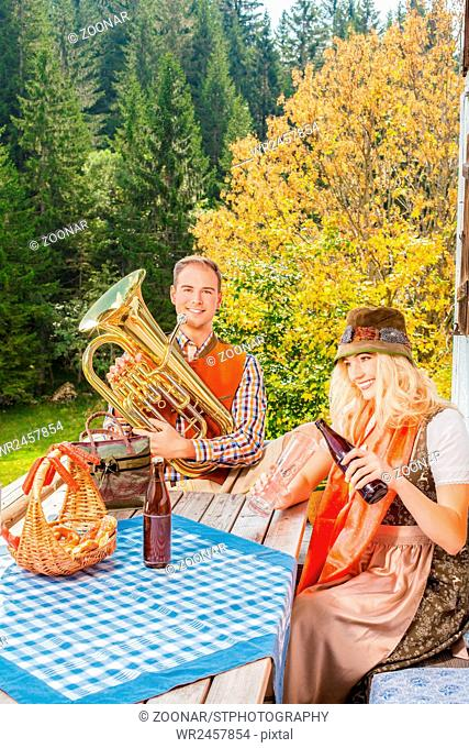 Young couple in traditional Bavarian costume at th