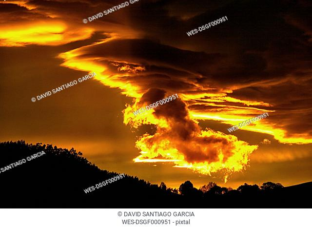 Spain, Asturias, Picos de Europa National Park, storm clouds at sunset
