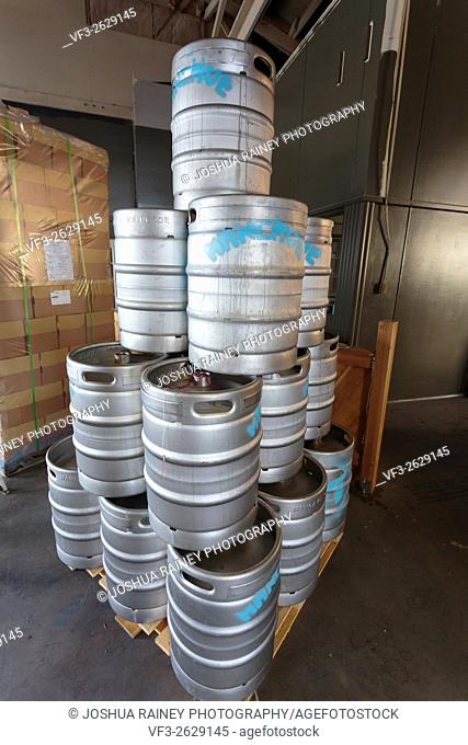 EUGENE, OR - NOVEMBER 4, 2015: Stainless steel beer kegs stacked together at the startup craft brewery Mancave Brewing