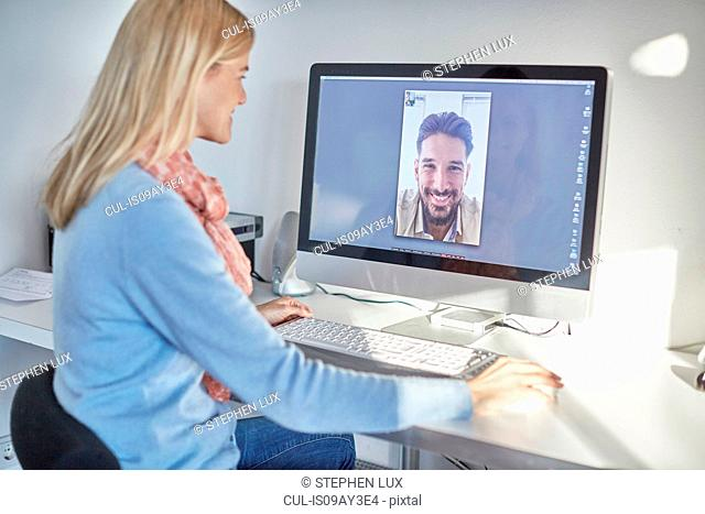 Woman making desktop video call to boyfriend