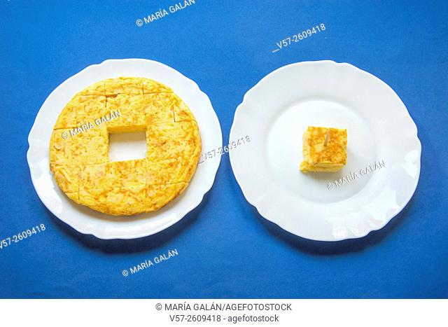 Spanish omelet cut into pieces in a dish, and a piece of it in another dish