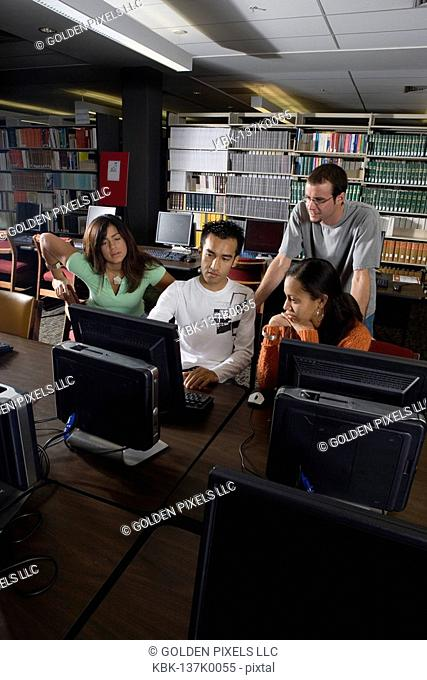 College students using computers in the library