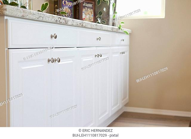 Close-up of white cabinets against the wall at home