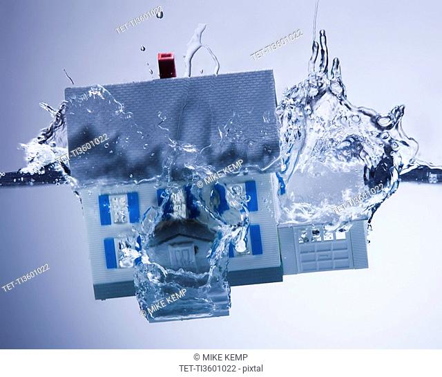 Model home sinking in water