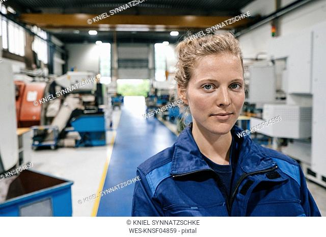 Young woman working as a skilled worker in a high tech company, portrait