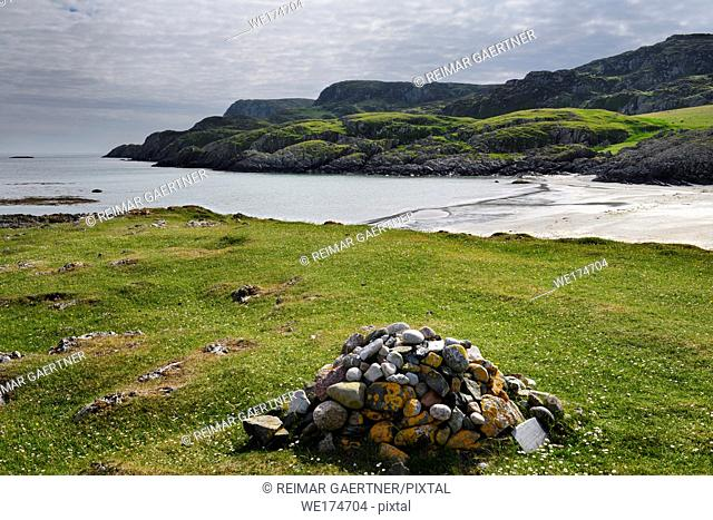 Cairn pile of stones on sea cliff at Sandeels Bay beach on Isle of Iona Inner Hebrides Scotland UK