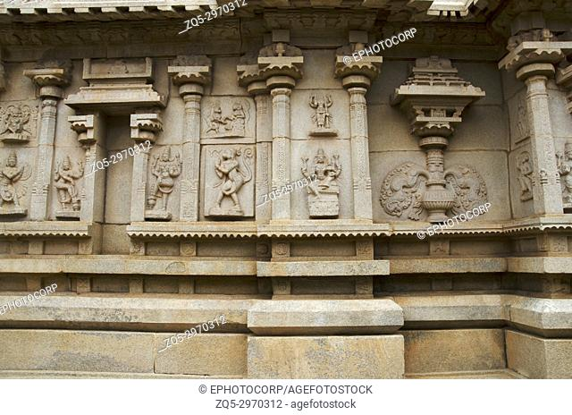 Carving details on the outer wall of Hazara Rama Temple. Hampi, Karnataka, India. Famous for the lovely bas relics and panels depicting the story of the epic...