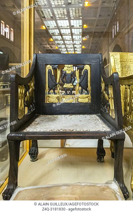 Egypt, Cairo, Egyptian Museum, from the tomb of Yuya and Thuya in Luxor : Wooden chair, painted and gilded. The feet are lion paws, in silver
