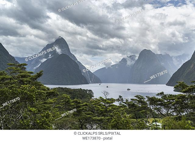 Elevated view of Milford Sound on a cloudy summer day. Fiordland NP, Southland district, Southland region, South Island, New Zealand