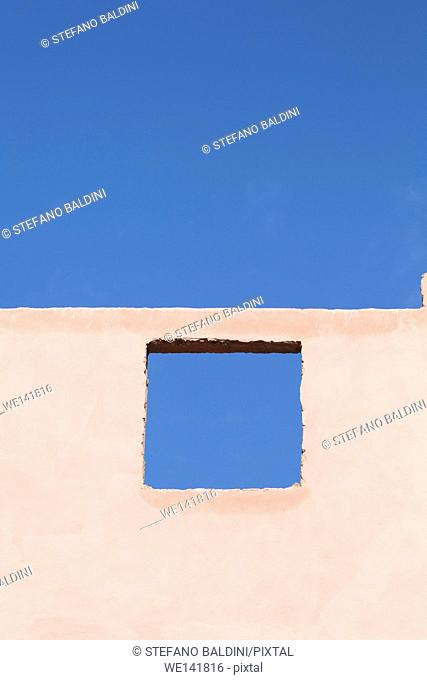 Sky view through a window in a roofless home, Morocco