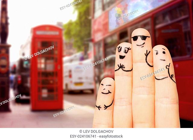 travel, tourism, family, people and body parts concept - close up of four fingers with smiley faces over london city street and red bus background