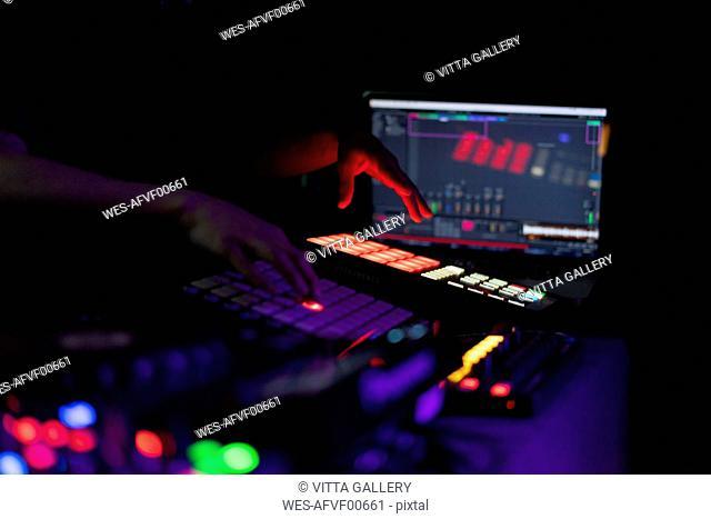 DJ working on drum machine