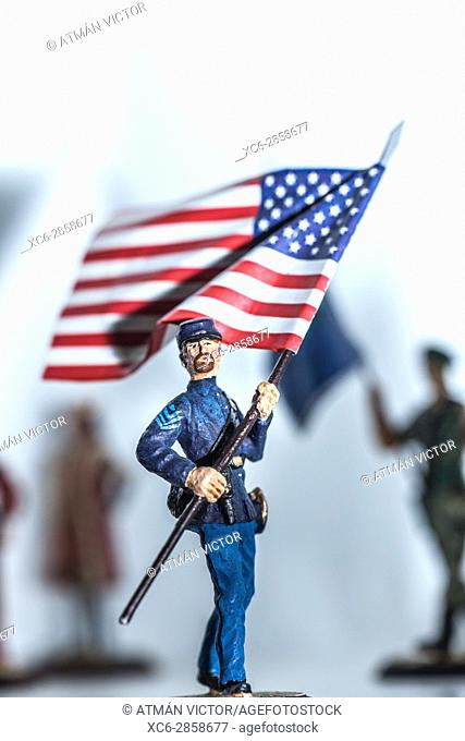 Tiny miniature vintage American Civil War soldier figurine holding the USA flag standing