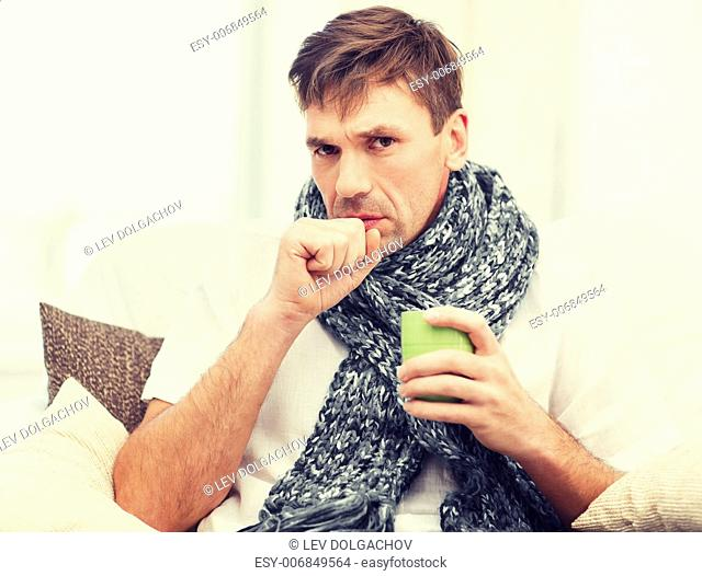 healthcare and medicine concept - ill man with flu at home