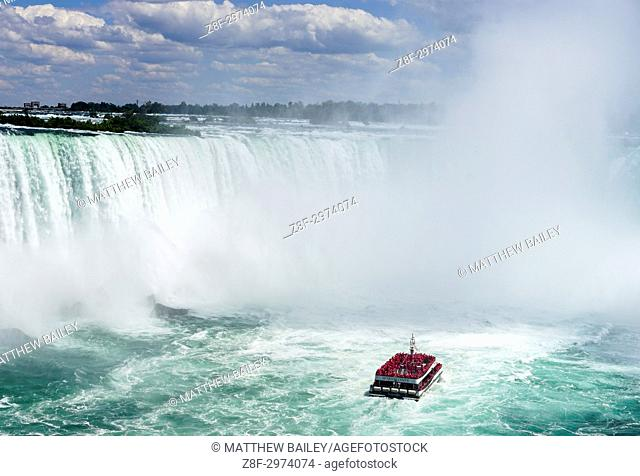 Hornblower Cruises taking people into the mist of Niagara Falls, Canada