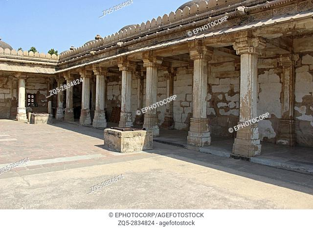 Colonnaded cloister of historic Tomb at Gujarat at Sarkhej Roza mosque in Ahmedabad, India