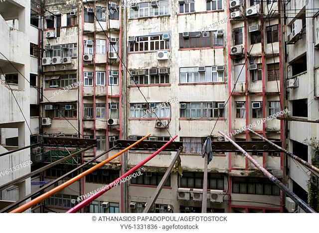 CHINA HONG KONG KOWLOON TSIM SHA TSUI NATHAN ROAD Postwar apartments in bad condition with noticeable the colored sticks that Chinese are using for drying...