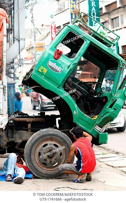 Truck under repair, Parian, Cebu City, Philippines
