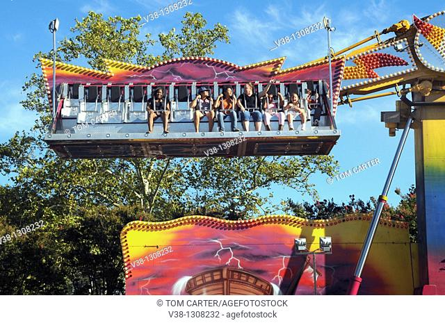 people enjoying a carnival ride