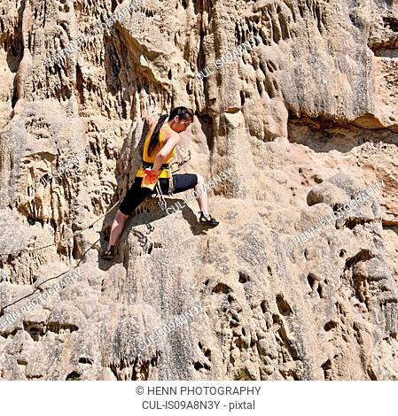 Female rock climber on rock face