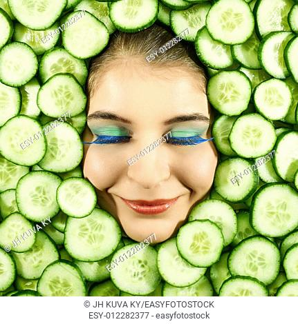 Beautiful woman expression face with cucumber slice frame