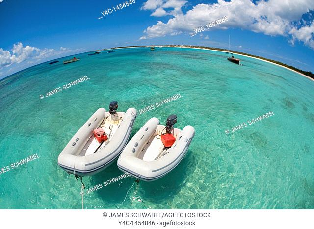 Rubber boats in Cove Bay on the caribbean island of Anguilla in the British West Indies