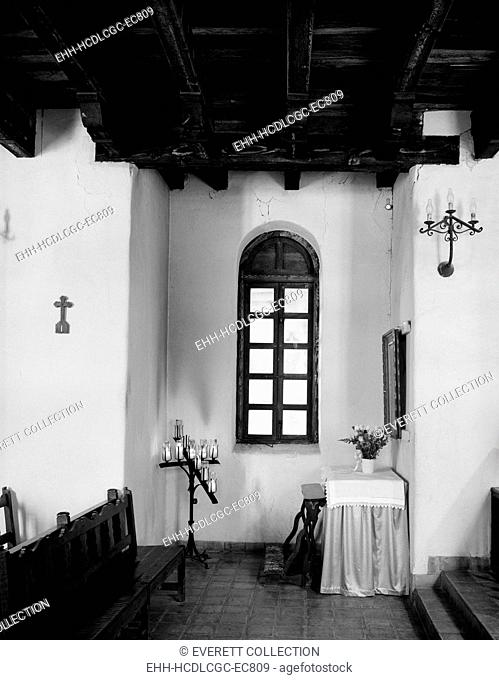 Mission San Francisco de la Espada, altar with crucifix and statues of Jesus, St. Francis of Assisi and the Virgin Mary. San Antonio, Texas