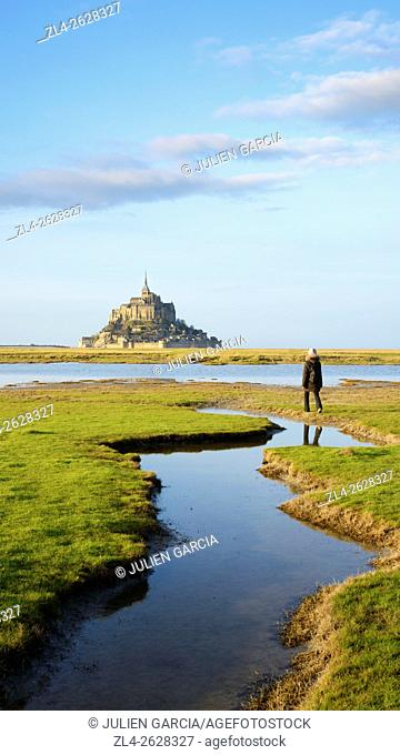 France, Normandy, Manche, Mont Saint-Michel Bay listed as World Heritage by UNESCO, Mont Saint-Michel seen from the salt marsh meadows, Model Released