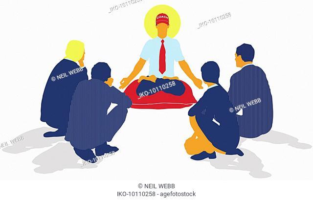 Businessmen and businesswomen surrounding coach sitting in lotus position