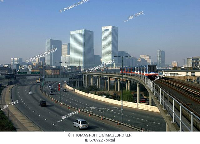 View of the new quarter Canary Wharf with its office buildings at the former docks in the east of London, Great Britain