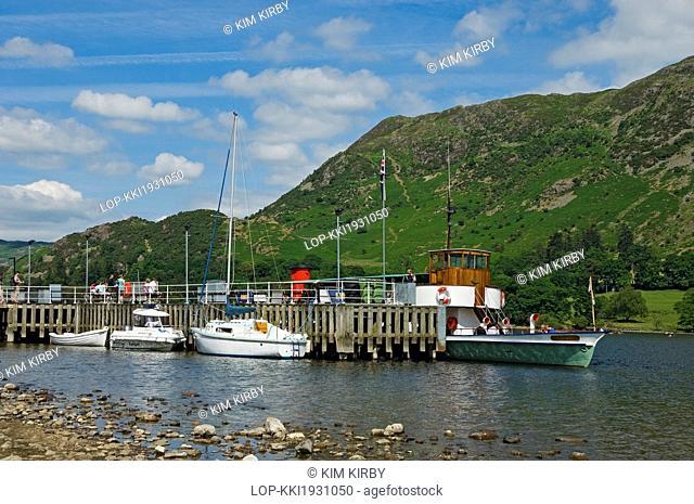 England, Cumbria, Ullswater. The Ullswater Steamer 'Raven' moored at Glenridding Pier on Ullswater