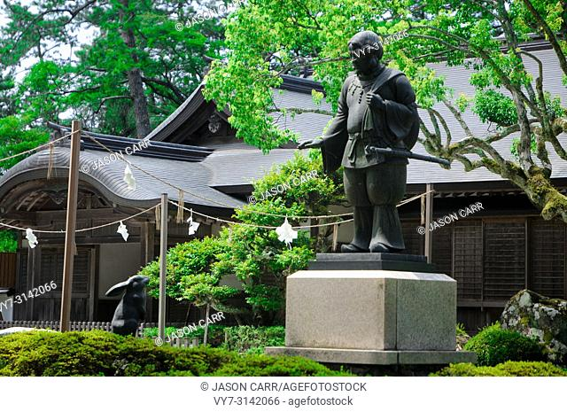 Statue at the Izumo Taisha Shrine in Shimane, Japan. To pray, Japanese people usually clap their hands 2 times, but for this shrine with the different rule