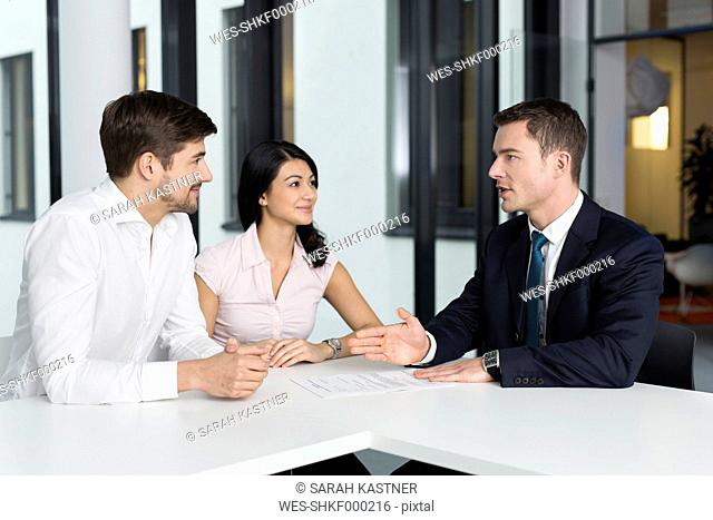 Consultant talking to couple