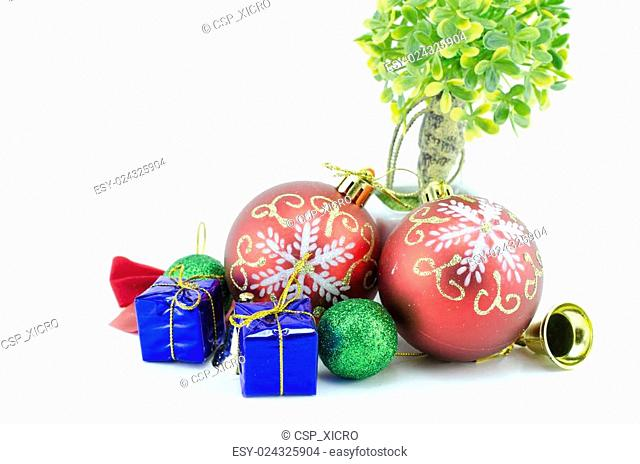 two red ball christmas ornamen with blue gift box, green ball, golden bell, ribbon and artificial green tree. isolated on white background