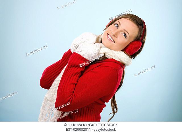 Beautiful young woman wearing a ear muffs and white scarf, horizon format