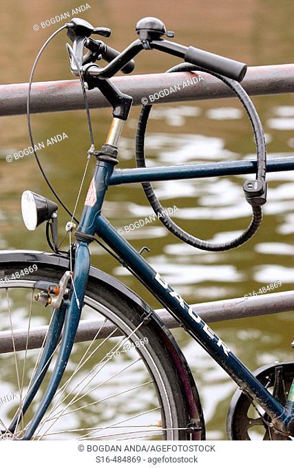 Bicycle chained to a walking rail - Dambovitza river banks, Bucharest, Romania