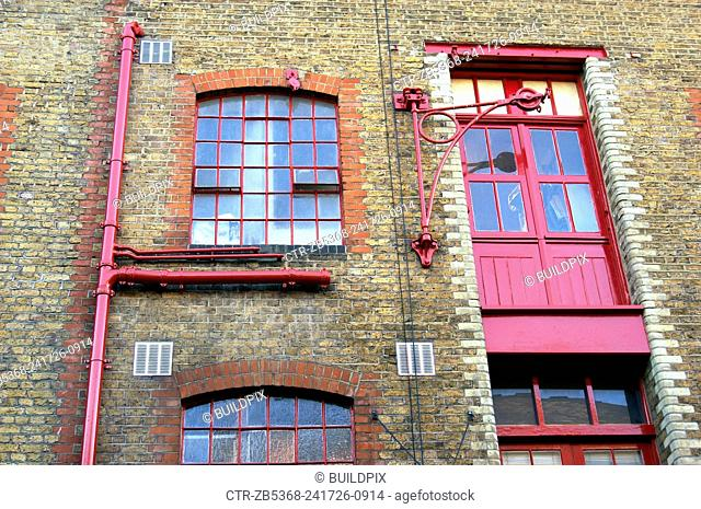 London regeneration. Victorian warehouses in the dockland area reconverted in expensive flats