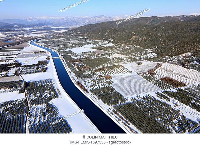 France, Alpes de Haute Provence, Les Mees in the snow, EDF canal and olive trees in the valley of the Durance (aerial view)